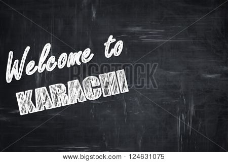 Chalkboard background with white letters: Welcome to karachi with some smooth lines