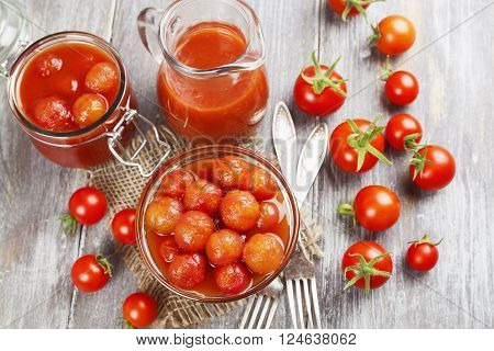 Canned tomatoes in tomato juice on a wooden table