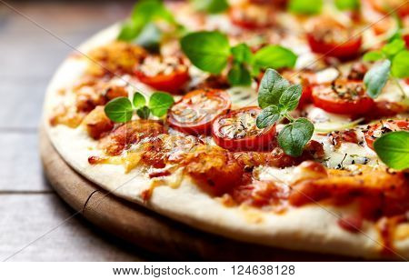 Pizza with cherry tomatoes with fresh oregano