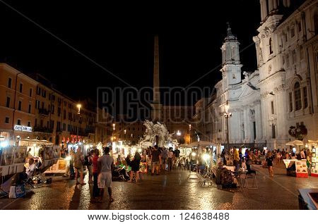 ROME-AUGUST 7: Piazza Navona on August 7 2013 in Rome. Piazza Navona is a city square built on the site of the Stadium of Domitian in 1st century AD in Rome Italy.
