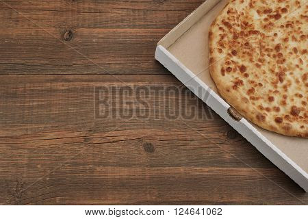 Round Cheese Pie Or Quatrro Formaggi Pizza On Brown Table