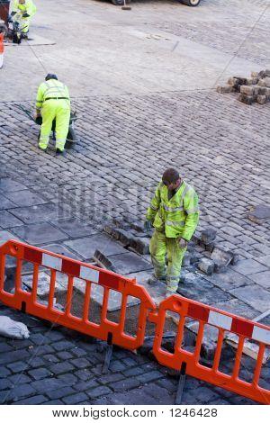 Workmen Laying Cobbles