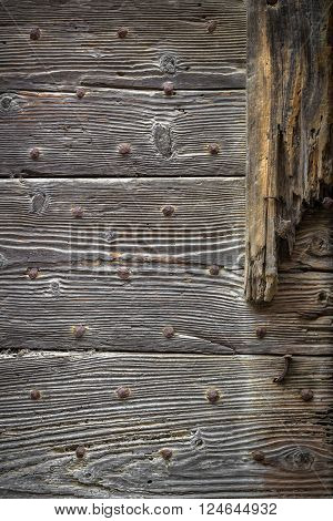 Gray wooden planks with rusted nails background photo texture.