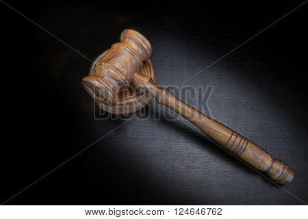 Judges Or Auctioneer Gavel On Black Wood Grunge Background