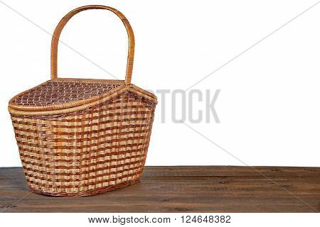 Picnic Basket Or Hamper On  Wooden Table Isolated