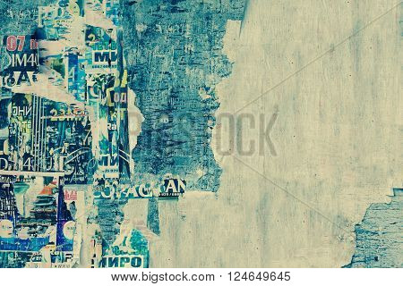 Weathered Torn Color Posters On The Old Wood Billboard Background