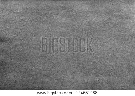 vintage texture of old paper or cardboard of dark gray color for a background and for wallpaper