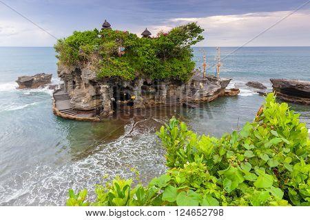 Pura Tanah Lot at sunset famous ocean temple in Bali Indonesia.