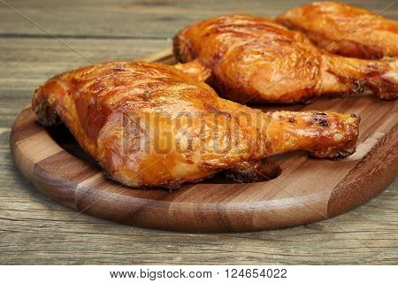 Three Grilled Bbq Chicken Leg Quarter On Wood Board