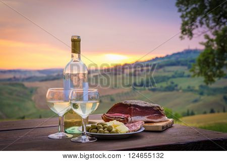 still life White wine  ,cheese and prosciutto. Romantic dinner  outdoors