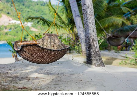 Relaxing holidays in tropical paradise - Hammock on a palm tree. Philippines