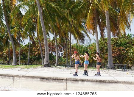 MIAMI BEACH, UNITED STATES - FEBRUARY 5: Girls roll at the sunny Crandon Park Beach of Key Biscayne on 5th of February, 2016 in Miami Beach.