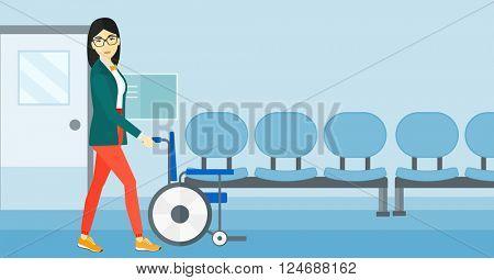 Woman pushing wheelchair.