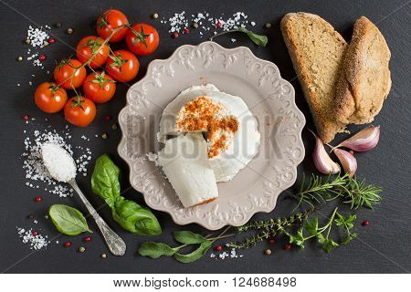 Italian ricotta cheese homemade bread vegetables and herbs top view