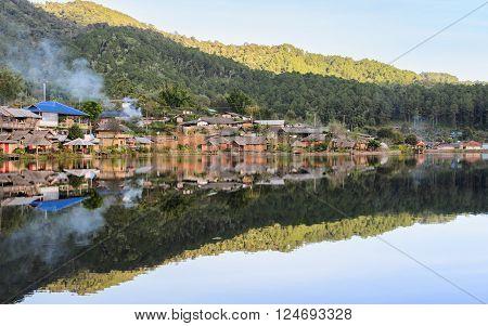 Beautiful view of Ban Rak Thai with reflection on lake Yunnan Chinese village in Mae Hong Son Thailand
