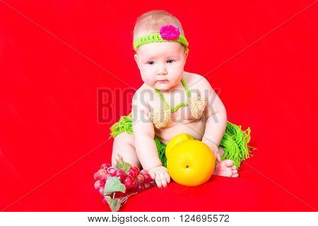 Portrait of adorable cute newborn little baby girl dressed Papuan