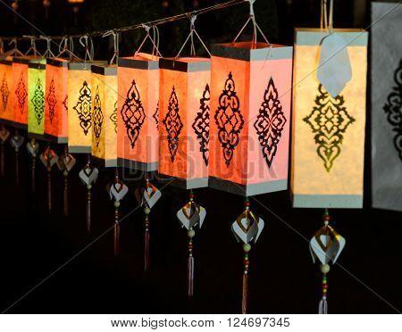 Colorful Lanna paper lantern illuminated at night in Loi Krathong festival or yeepeng lantern festival Thailand
