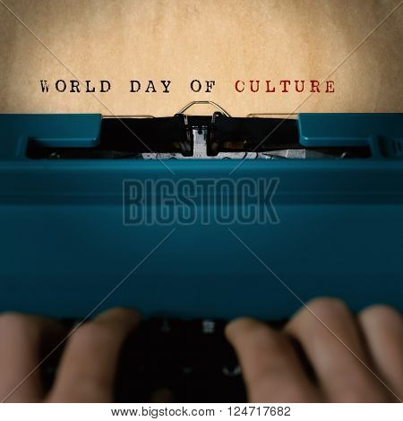 the text world day of culture written in a yellowish paper with a blue retro typewriter