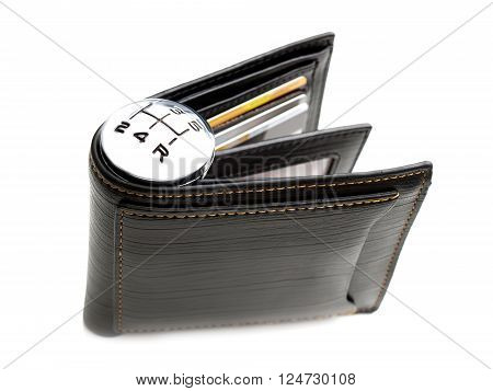 Gear shift marks on a wallet as a concept related with spending of money.