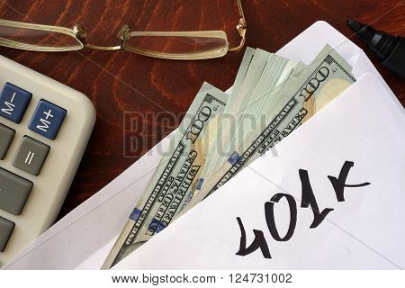 401k written on an envelope with dollars. Savings concept.