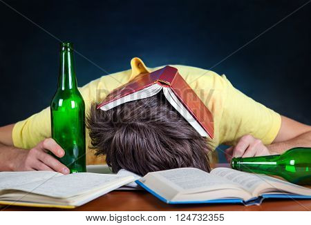 Student with the Beer sleep on the Books