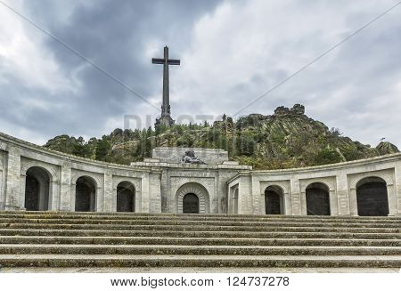 Facade of the main building and cross of Valley of the Fallen (Valle de los Caidos) Madrid Spain.
