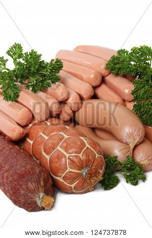 Various kinds of sausage decorated with parsley isolated on white background