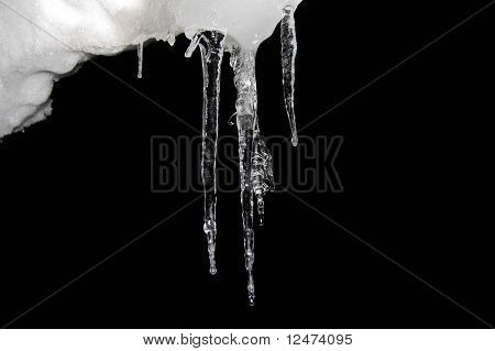 Icicles floating on a night sky