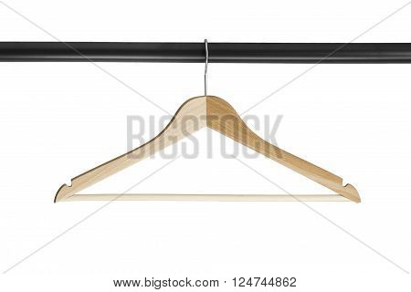 Wooden clothes rack on metal crossbar isolated over white