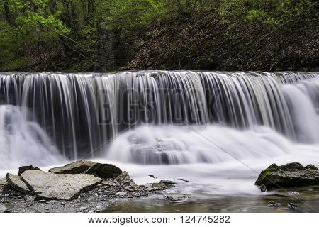 Silky Waterfall. Long exposure creates a icy appearance in waterfall photo.