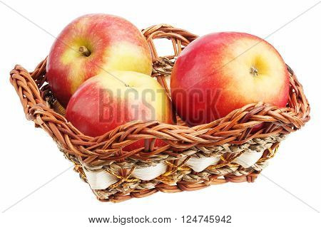 Apples in a wicker dish isolated on white background