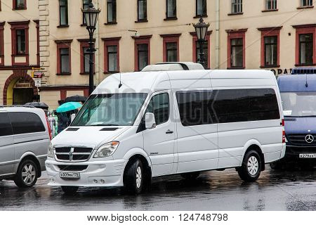 SAINT PETERSBURG, RUSSIA - MAY 25, 2013: White compact bus Dodge Sprinter in the city street.