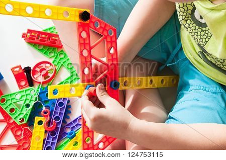 A cchild plays in the colorful constructor