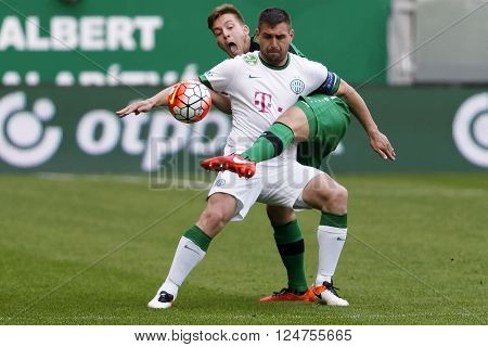 BUDAPEST, HUNGARY - APRIL 6, 2016: Daniel Bode of Ferencvaros (r) covers the ball from Kristof Papp of Paks during Ferencvaros - Paks OTP Bank League football match at Groupama Arena.