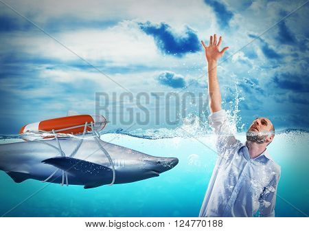Shark with lifebelt and desperate drowning man