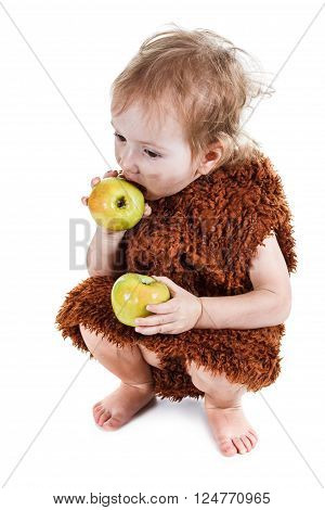 Little funny Neanderthal boy in a suit with a dirty face eating an apple. Humorous concept ancient caveman. Isolated on white. poster