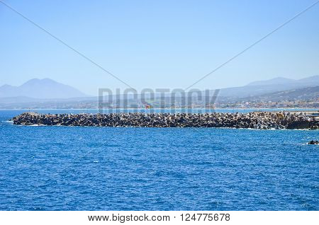 Waves Beat Against The Breakwater In Rethymnon