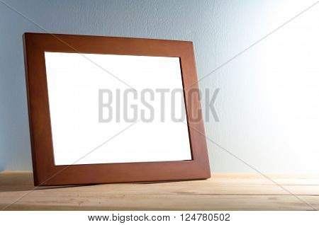 wooden photo frame on wooden table over grunge background Still life style