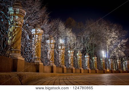 Night view of the fence of the Mikhailovsky Garden in the temple of Savior on Spilled Blood, St.Petersburg, Russia