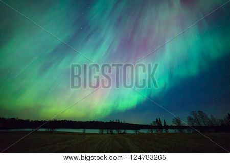 Northern lights aurora borealis landscape in Finland