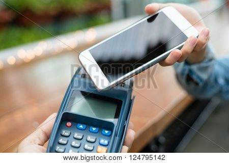 Customer pay with cellphone on NFC technology