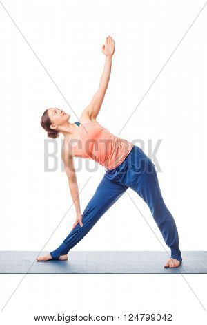 Beautiful sporty fit woman practices yoga asana utthita trikonasana - extended triangle pose beginner variation isolated on white background