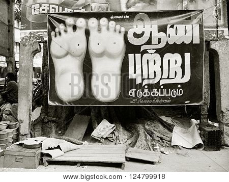 MADURAI INDIA - June 22 1992: A poster advertises street-side reflexology on June 22 1992 in Madurai Tamil Nadu India.
