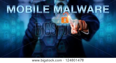 Network administrator pointing at MOBILE MALWARE on an interactive touch screen interface. Business challenge metaphor and information technology concept for malicious software targeting the cloud.