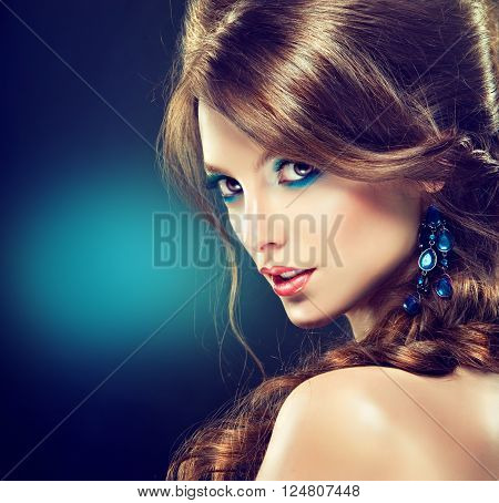 Model girl with blue makeup.   Braid hairstyle with fleece .   Cosmetics , makeup and cosmetology .