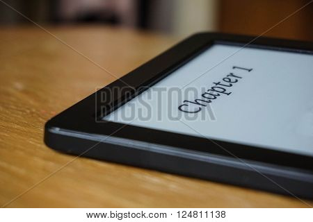 Electronic reader with a caption Chapter 1 in electronic Ink on the display