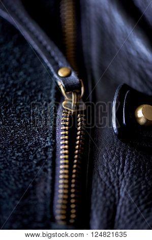 ajar the zipper on a black leather bag