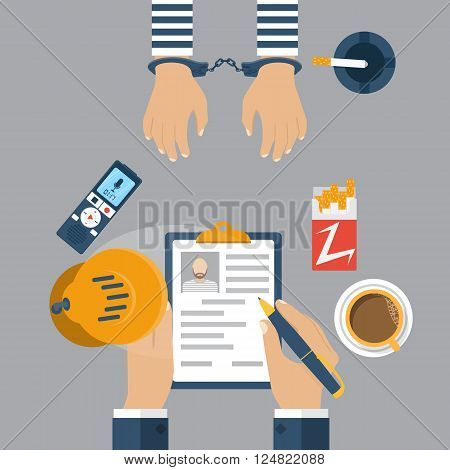 Police Detective Interrogating A Prisoner In Handcuffs