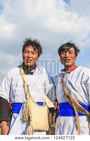 Heqing, China - March 15, 2016: Chinese Men In Ancient Bai Yi Clothing During The Heqing Qifeng Pear