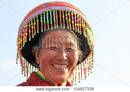 Heqing, China - March 15, 2016: Chinese Woman In Traditional Miao Attire During The Heqing Qifeng Pe